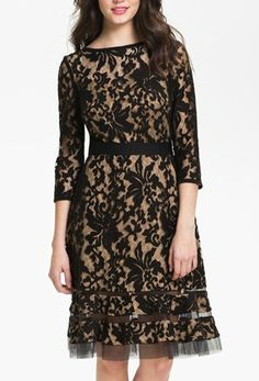 Black and nude peekaboo lace dress