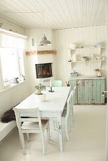 Dream dining area in this Scandi style kitchen....fireplace is perfect