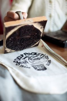 Self promotion idea.  Block printing/carving a logo or a message to imprint on packaging and other marketing materials.