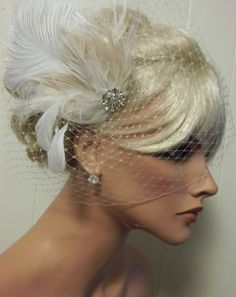 Ivory bridal hair fascinator rhinestone jewel feather fascinators wedding hair clip, feather hair clip -ship ready. $68.00, via Etsy.