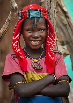 Happy face.  Africa |  Banna tribe girl - Key Afer Ethiopia | © Eric Lafforgue