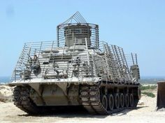 U.S. Army armoured recovery vehicle M88. Note the anti-RPG screens.