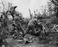 """Mortar crewmen drop another round down the tube near the Rapido River on January 24, 1944. Before the attack, the 36th Division commander, Major General Fred L. Walker, had scribbled in his diary, """"We are undertaking the impossible, but I shall keep it to myself."""""""