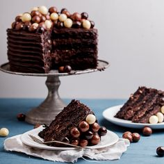 Dense, fudgy coffee chocolate cake with rich, dark chocolate and coffee frosting topped with a mountain of chocolate malt balls.