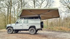 The is our standard vehicle mounted canvas awning. It offers rapid shelter from the elements & easy set-up & pack away. Aluminium side-arms fold out to support the awning with twist and pull. Defender Camper, Land Rover Defender 110, Landrover Camper, Awnings Uk, Land Rover Camping, Canvas Awnings, 4x4 Accessories, Big Country, Van Life
