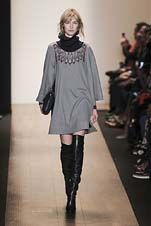 27-BCBGmaxazria Fall/Winter 2015/2016 Collection cape over contrasting high neck love this with the black thigh highs