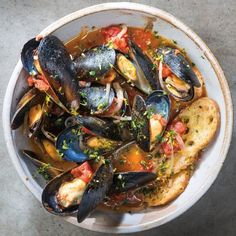 Cooked mussels Cremolata recipe. Mussels cooked with vegetables, herbs, dry white wine, and cream. Very easy and delicious!