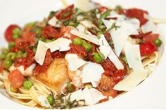 Pan fried Shrimp & Scallops with fresh linguine, peas, sun dried tomatoes and pecorino romano cheese