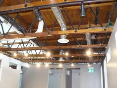 Stained truss chords and painted steel webs create additional drama in the salon