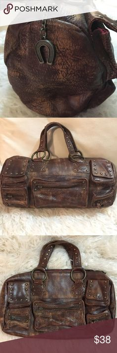 Betsey Johnson handbag Brown leather tube Betsey Johnson handbag. Missing 2 zipper pulls as show on picture. Everything else is perfect. Betsey Johnson Bags