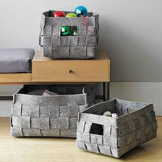 Woven Felt baskets - I bet I could make these...I've been looking for good storage baskets for DVD's hat won't scratch the wood shelves..hmmm