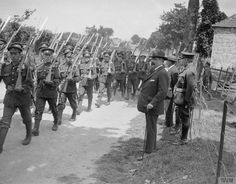John R. Bennett, the Newfoundland Minister of Militia, inspecting troops of the Royal Newfoundland Regiment at Ecuires, 25 June 1918.