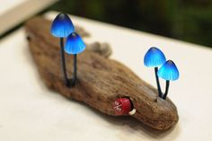 LED Mushroom Lights by Japanese designer Yukio Takano of The Great Mushrooming. The synthetic funghi are constructed out of glass to look as if they are growing out of the found wood of logs and tree stumps.
