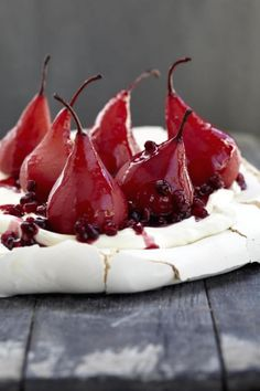 Pavlova with poached pears & pomegranate on www.nomu.co.za