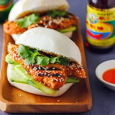 A chicken burger with a distinctly Asian twist, made with soft mantou buns and chilli hot marinated chicken. Chicken Buns, Asian Chicken, Marinated Chicken, Grilled Chicken, Speedy Recipes, Dinner Is Served, White Meat, Wrap Recipes, Wrap Sandwiches
