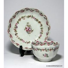 New Hall Fluted 'Pink Ribbon' Porcelain Tea Bowl & Saucer c1790Marks : Unmarked but well known pattern copied from Chinese imports Origin : Staffordshire, England Colour : Puce, red and green. Pattern : 'Pink ribbon' Number 186 Features : Fluted form. Two painted bands of ribbon swags and flowers surround a central floral spray. Hard paste