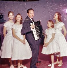 "April 1957. ""Entertainer Lawrence Welk playing accordion with the Lennon Sisters."" Color transparency by Earl Theisen for the Look magazine assignment ""Lawrence Welk: Nobody Likes Him Except the Public."""