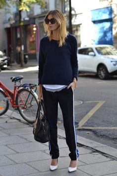 wearing an angora knit and sporty pants  both by Sandro, a white tee by LNA clothing layered over a mesh tee by IRO and Mango wegdes. The bag and the sunnies are Celine and the ID bracelet is ASOS.
