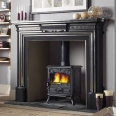 Convert your fireplace into a wood burning stove. These are great for heat and cooking during a power outage situation. Wood Burner Fireplace, Cast Iron Fireplace, Faux Fireplace, Fireplace Surrounds, Fireplace Design, Fireplace Ideas, Style At Home, Log Burning Stoves, Wood Burning
