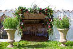 flower garland entrance - Read more on One Fab Day: http://onefabday.com/a-marquee-wedding-by-elisha-clarke/