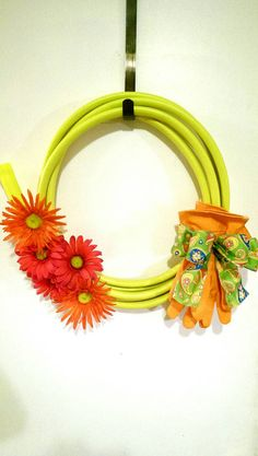 Check out this item in my Etsy shop https://www.etsy.com/listing/229012857/summer-wreath-garden-hose-wreath-garden