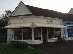 New Triangular fixed canopies for Eden florist in Leatherhead Surrey by Deans Blinds & Awnings