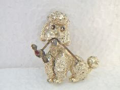 vintage poodle brooch pin flower in mouth by ALEXLITTLETHINGS
