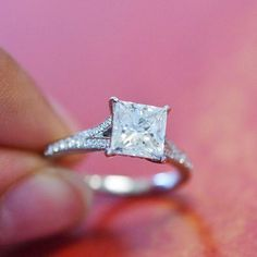 Love this elegant engagement ring featuring claw prongs and accent diamonds.