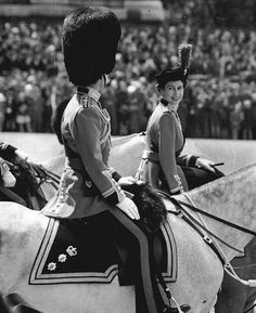 Queen Elizabeth II and Prince Philip, Duke of Edinburgh - pictured riding together in 1954 at Trooping the Colour .