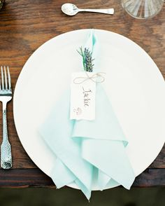 Blue was yet again seen in the place settings, with the baby blue napkins that were tied with each guest's name, complete with a tiny mushroom illustration by Julie Himes and a sprig of lavender. Hammered silverware was also selected to match Jackie's hammered ring.