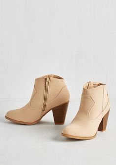 Best of Both Twirls Bootie. Whether youre a little bit country or rock n roll, these tan booties offer strut-worthy flair for every kind of fashionista! #tan #modcloth