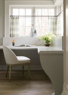 Curved bracket built-in desk and cafe curtains, this time in a horizontal-stripe sheer    Phoebe Howard