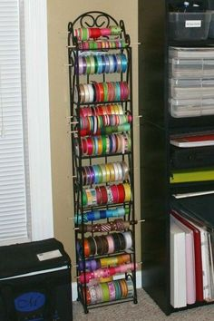 using a wine rack for ribbon storage. (Juxtapost)