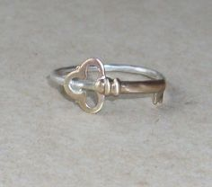 Key Sterling Silver and Brass Stacking Ring by ShireJewelry, $15.99  give me the key to your heart<3
