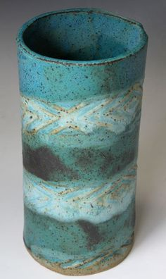 Bridges Pottery Vase...of course , the colors on this vase are my favs...oceanic hues.