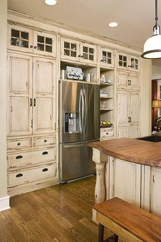 Inspiring Distressed Kitchen Cabinets With Wooden Chair. This picture is one of many ideas on best distressed kitchen cabinets. Distressed Kitchen Cabinets, Kitchen Cabinets Decor, Farmhouse Kitchen Cabinets, Modern Farmhouse Kitchens, Kitchen Cabinet Design, Rustic Farmhouse, Farmhouse Style, Glass Cabinets, Kitchen Ideas