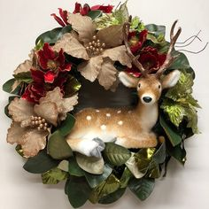 Personalised wreath with Christmas reindeer. Burlap floristry picks with green leaves and red camellia. Diy Christmas Gifts, Christmas Tree Cookies, Christmas Star, Christmas Gift Baskets, Christmas Ornaments, Christmas Music, Artificial Christmas Wreaths, Holiday Wreaths, Autumn Wreaths