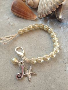 """""""Pearls in the Sand"""" SOLD:)). Simple casual and classy elegance :) Glass pearls that I hand wove myself, to create this easy to wear, classy touch of the beach!:) Sterling silver starfish dangle and a hand wired pearl both add a touch of whimsy:) $30.00. Just leave me a message.. Your bracelet will ship and arrive in my signature gift box with ribbon for $1.75:) Thanks, Julia"""