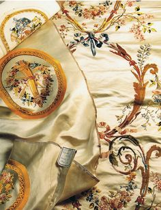 """This silk, ordered by Ganoin, was ordered in 1779    for the winter furnishings of Marie-Antoinette's    private apartments at Versailles. The panel in the    photograph is a Second Empire copy (c. 1859)    woven for the Empress Eugenie's private    apartments in the Tuileries Palace""    Silk    Jacques Anquetil"