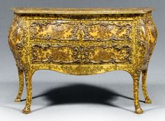 Venetian Louis XV style commode,[laca povera] style, bombé form with two drawers, carved and applied composition ornament and applied printed decoupage decoration with heavy resin(?) coating, possibly 18th century