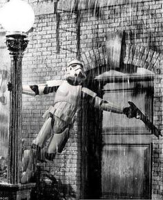Just singing in the rain. Wow, stormtroopers in a musical.