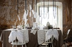 """Really cool idea—this """"Christmas dinner with angel wings & feathers"""" theme is so fun, pretty & ethereal."""