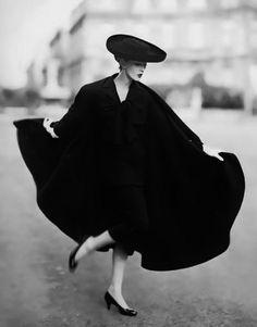 Dovima photographed by Richard Avedon in the Place Francois Premier, Paris, August 1955. Cape Lanvin-Castillo