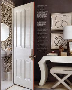 {LoVe how the side of the door is painted. It's subtle, but adds a great punch to the monochromatic decor around it}