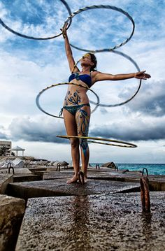 Sam Carpio shows her beautiful self-made body art while spinning multiple hula hoops at the beach in Cancun, Mexico. Gorgeous! Photo by Nicolas Eumir Lemus Gonzalez. A Hooping.org Photo of the Day.
