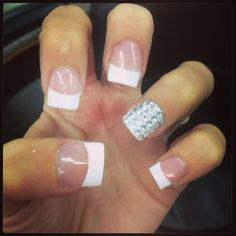 For these nails you get a French tip and on your ring finger get nail gem stones and put them on rows covering the whole nail. Then put a clear coat and you are done.