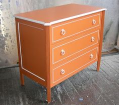 Orange paint on furniture. goes with the orange and white bedroom