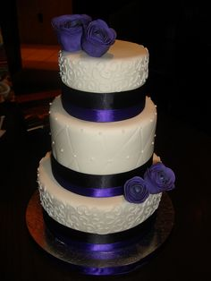 Mini 3 tier dark purple wedding cake by murnahan, via Flickr
