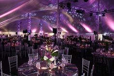 LED lighting with stars theme under a pole tent.