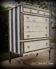 Love the painted stripes and vintage touches on this dresser~ it wouldnt be that hard to do!